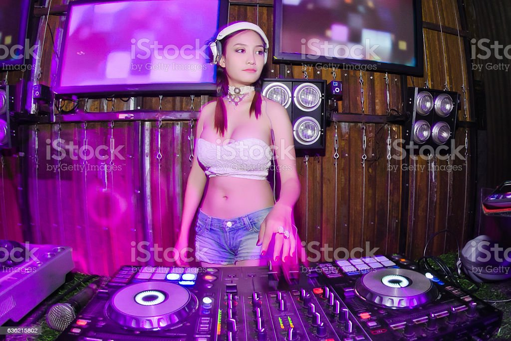 Blurred Lady Dj in club party, stock photo