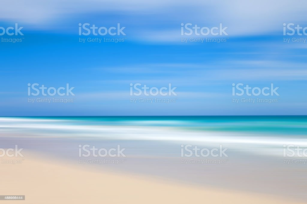 Blurred landscape: defocused beach, turquoise sea and blue sky stock photo