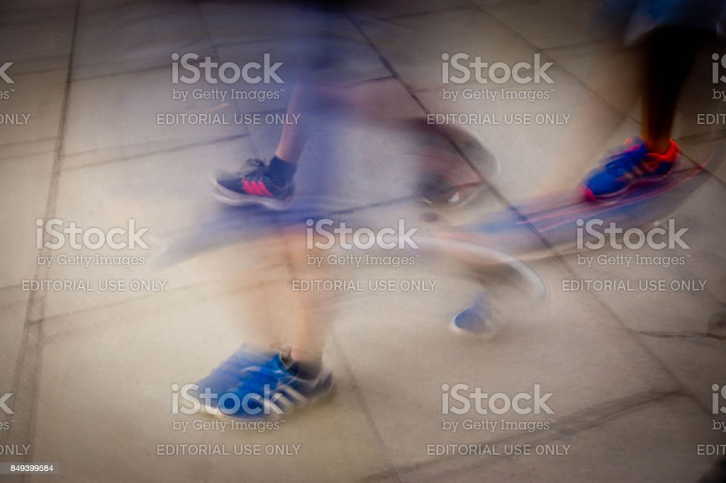 Blurred legs stock photo