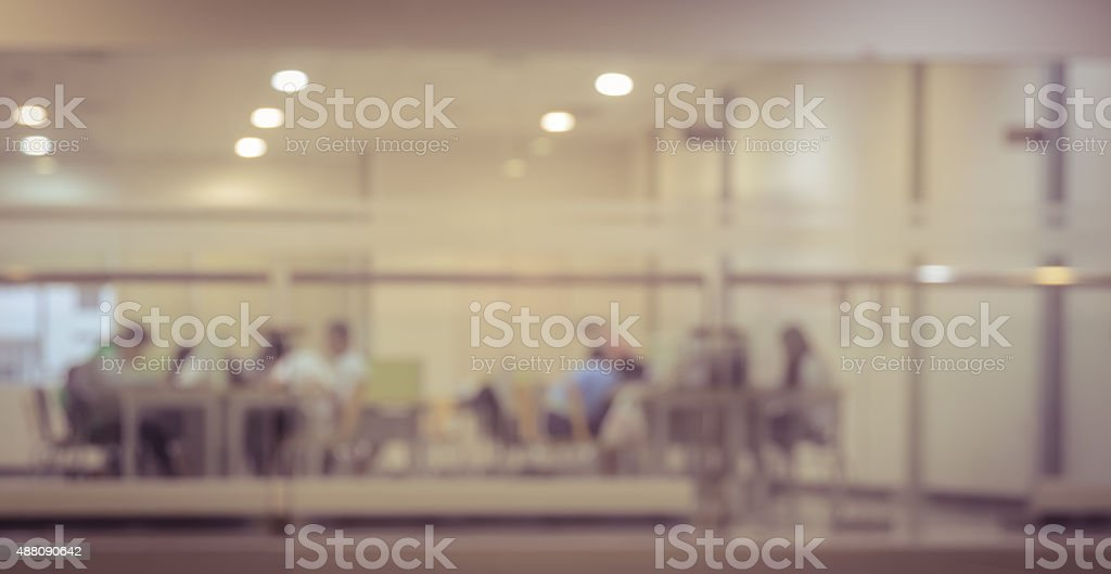 Blurred library room interior background Blurry reading area in  public library, vintage filter effect 2015 Stock Photo