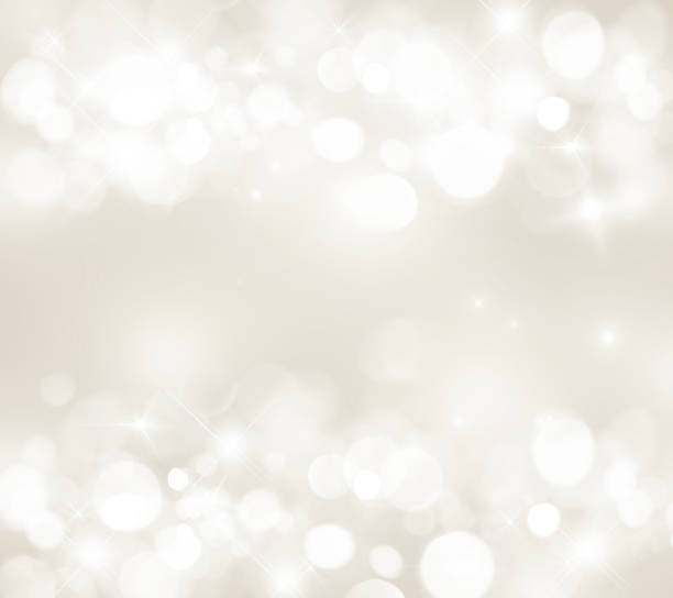 blurred light beige background; bokeh; white circles; festive; glitter; light - beige background stock photos and pictures