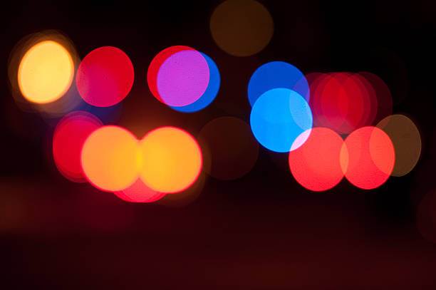 Blurred lights from emergency vehicles at night stock photo