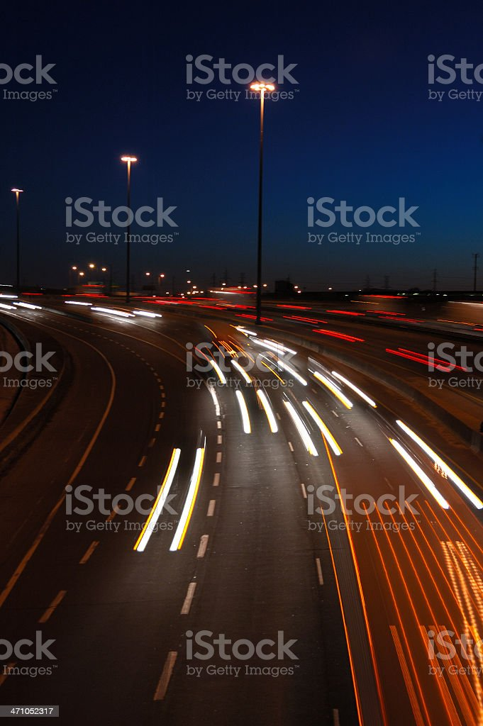 Blurred lights of cars moving along a highway royalty-free stock photo
