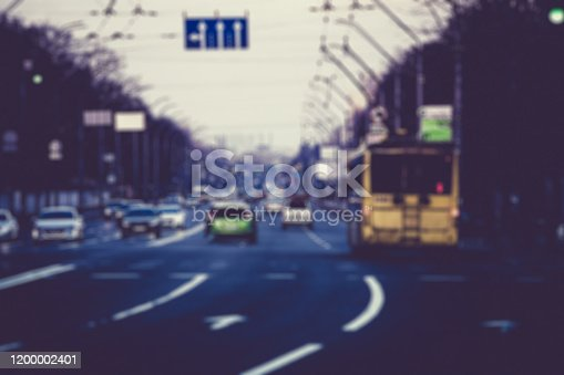 820883024 istock photo Blurred lights of road traffic cars on street at evening 1200002401