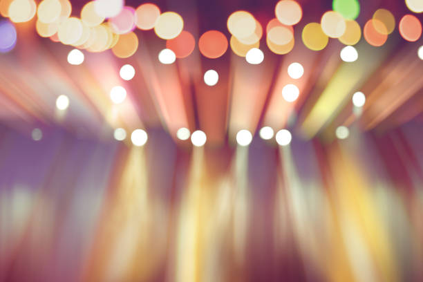 blurred lights on stage, abstract image of colourful lighting, background party blur celebration concept. stock photo