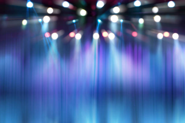 blurred lights on stage, abstract image of concert lighting stock photo
