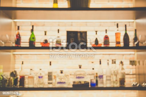 1013514594 istock photo blurred liquor bar in Vintage photo filter style. 953972476