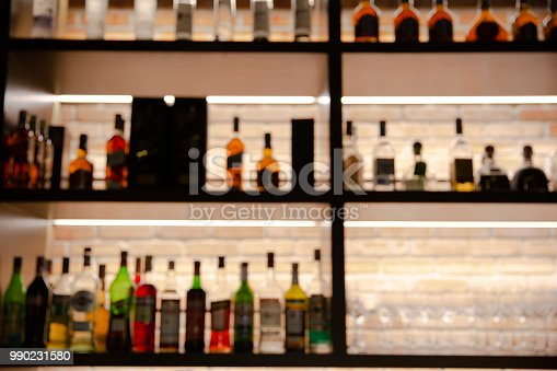 1013514594 istock photo blurred liquor bar in Vintage photo filter style. 990231580