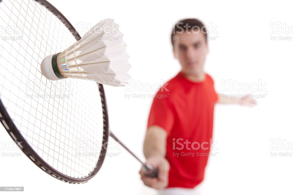 Blurred man playing badminton with racket and shuttlecock royalty-free stock photo