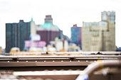 (Selective focus) Blurred Manhattan skyline seen from the Brooklyn bridge. Manhattan, New York City, USA.
