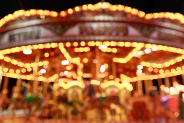 blurred merry-go-round - karussell stock-fotos und bilder