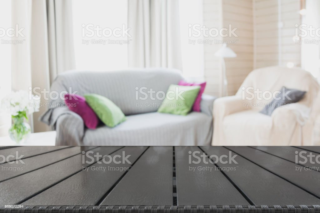 Blurred modern living room interior in rustic style with chair, soft divan. Abstract background for design. stock photo