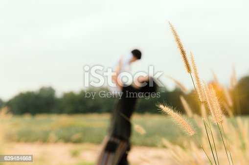 istock Blurred mom holding her kid to sky for love background. 639484668