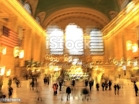 New York, Manhattan, USA - January 18, 2016: High angle view of blurred motion large group of people walking on granite floor of Grand Central Station. Grand Central Station is a commuter rail terminal located at 42nd Street and Park Avenue in Midtown Manhattan. Opened in 1913 and it is one of the famous landmark of New York City.