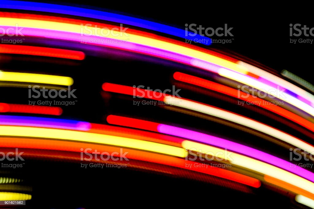 Blurred Motion Effect Around Of Brightly Illu . illuminated Rotating High Speed Carousel . abstract view - foto stock