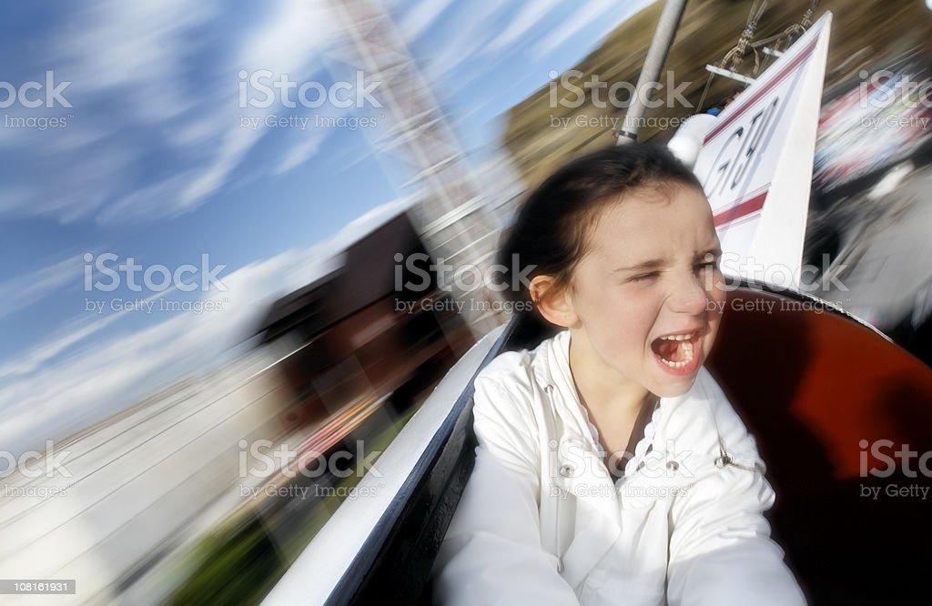 Blurred Motion, Little Girl Having Fun on Amusement Park Ride stock photo