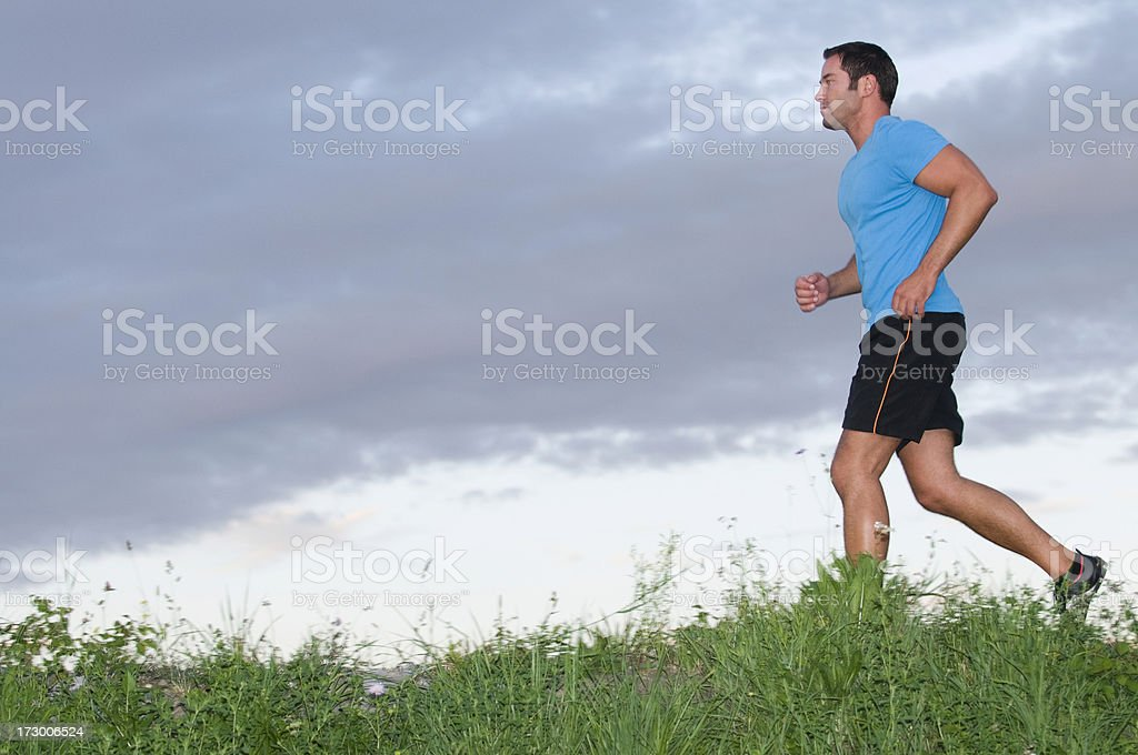 Blurred motion of a running man on a cloudy day royalty-free stock photo