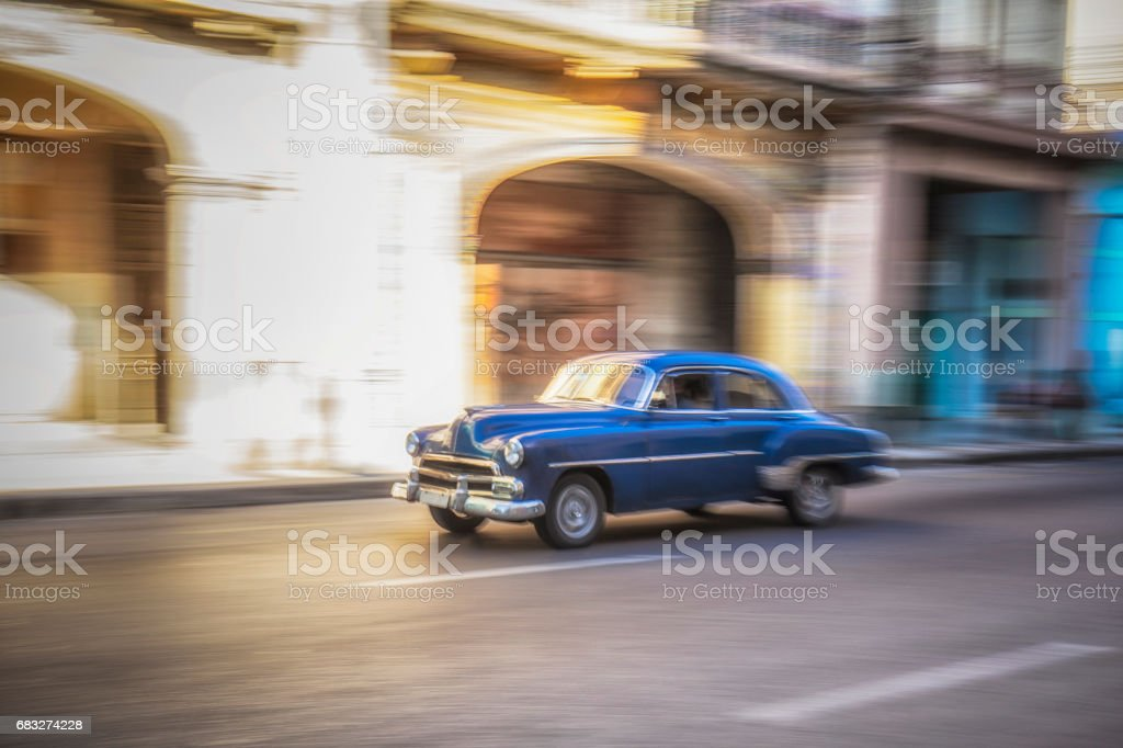 Blurred motion of blue taxi on street in city royalty-free stock photo