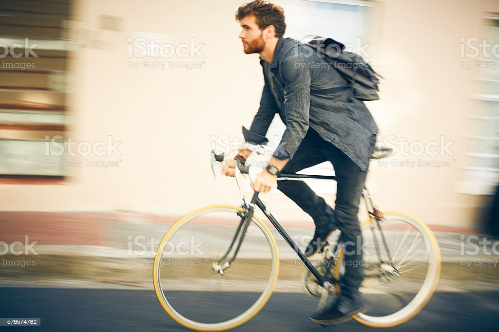 Blurred motion of man riding bicycle stock photo