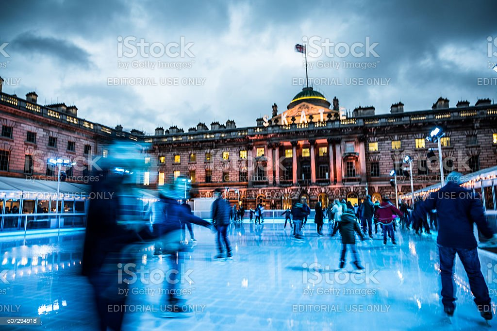 Blurred motion of People Ice Skating at Somerset House, London stock photo
