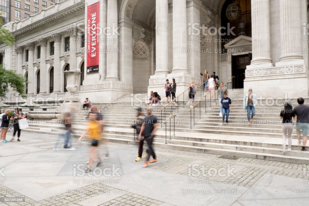 Blurred Motion Of People Walking Up The Steps To Enter The