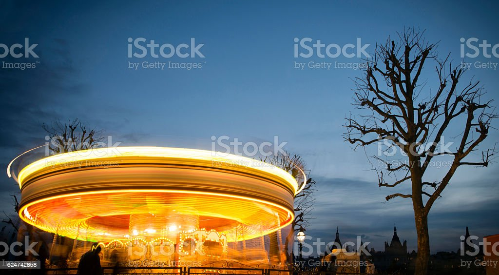 Blurred motion of side of carousel stock photo