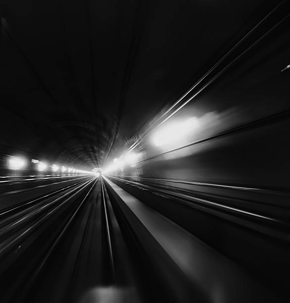 blurred motion of subway train in tunnel - milan railway foto e immagini stock