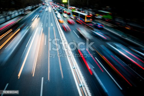 istock Blurred motion of traffic in the city at night 163690040