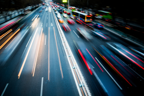 175130389 istock photo Blurred motion of traffic in the city at night 163690040