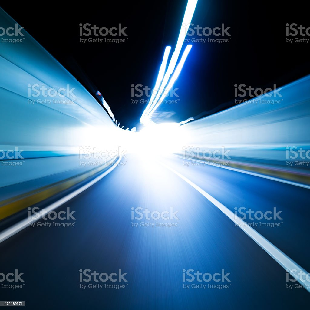 Blurred motion of tunnel drive at night stock photo