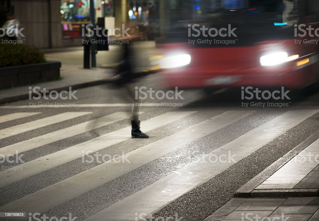 Blurred motion photo of woman crossing the street stock photo