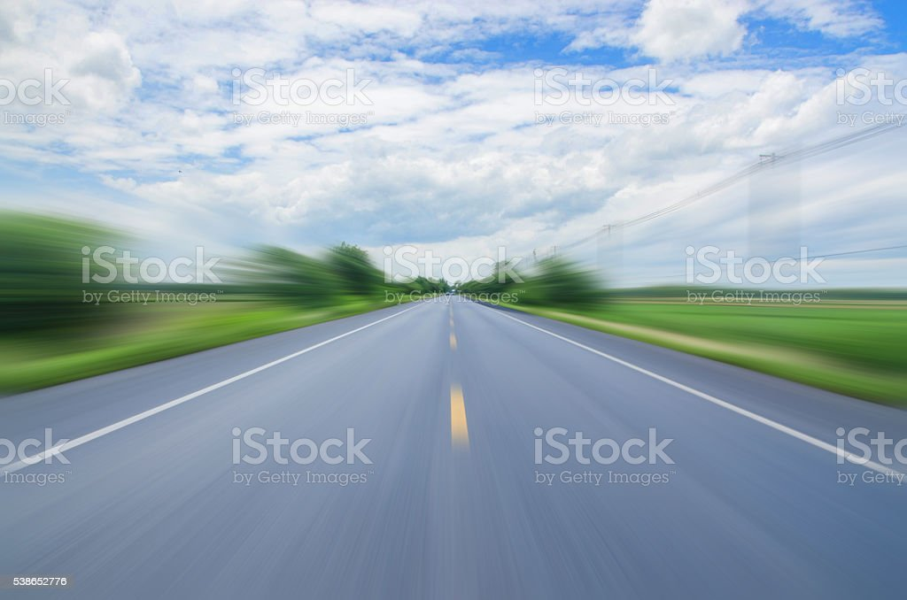 blurred motion rides along the country road stock photo