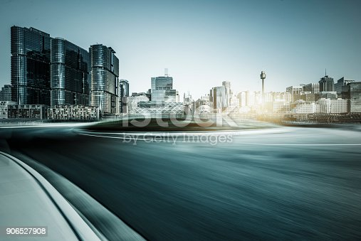 istock blurred motion road travel through modern skyscrapers of Sydney 906527908
