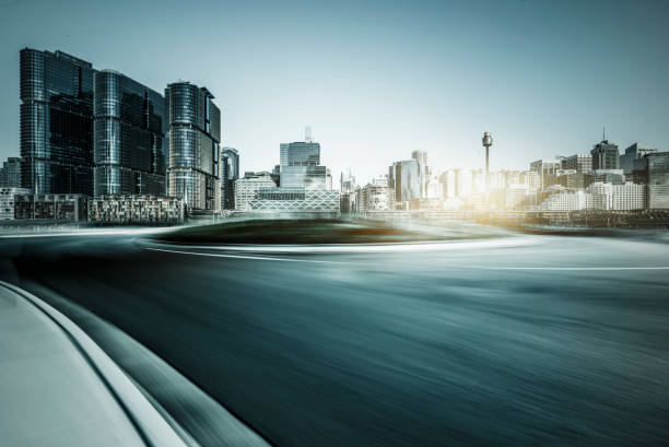 blurred motion road travel through modern skyscrapers of Sydney stock photo