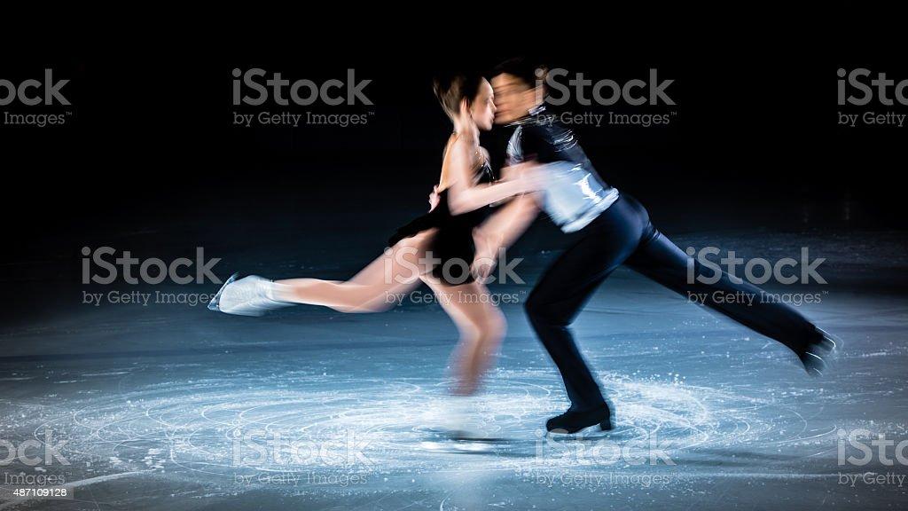 Blurred motion shot of figure skating pair performing stock photo