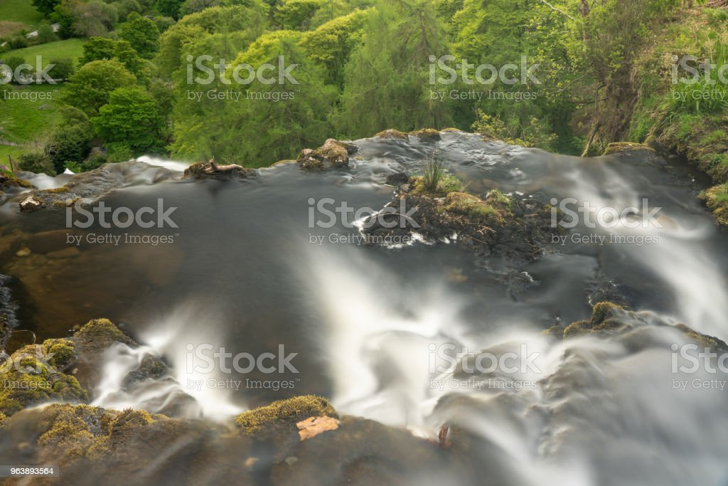 Blurred motion stream falls from top of waterfall of Pistyll Rhaeadr - Royalty-free At The Edge Of Stock Photo