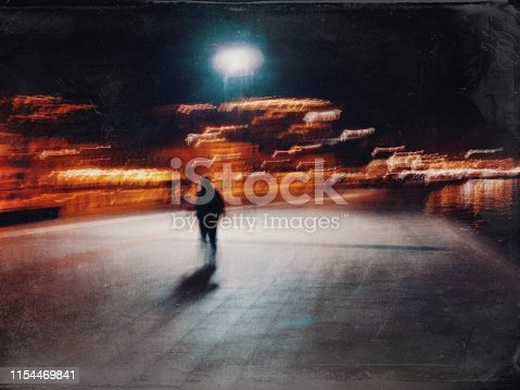 istock Blurred motion view of the man walking in the street at night 1154469841
