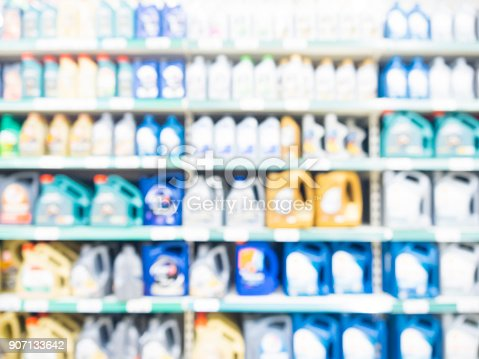 istock Blurred motor oil on shelves in supermarket 907133642