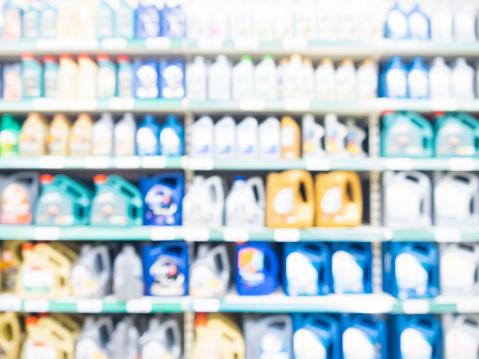 istock Blurred motor oil on shelves in supermarket 907133642