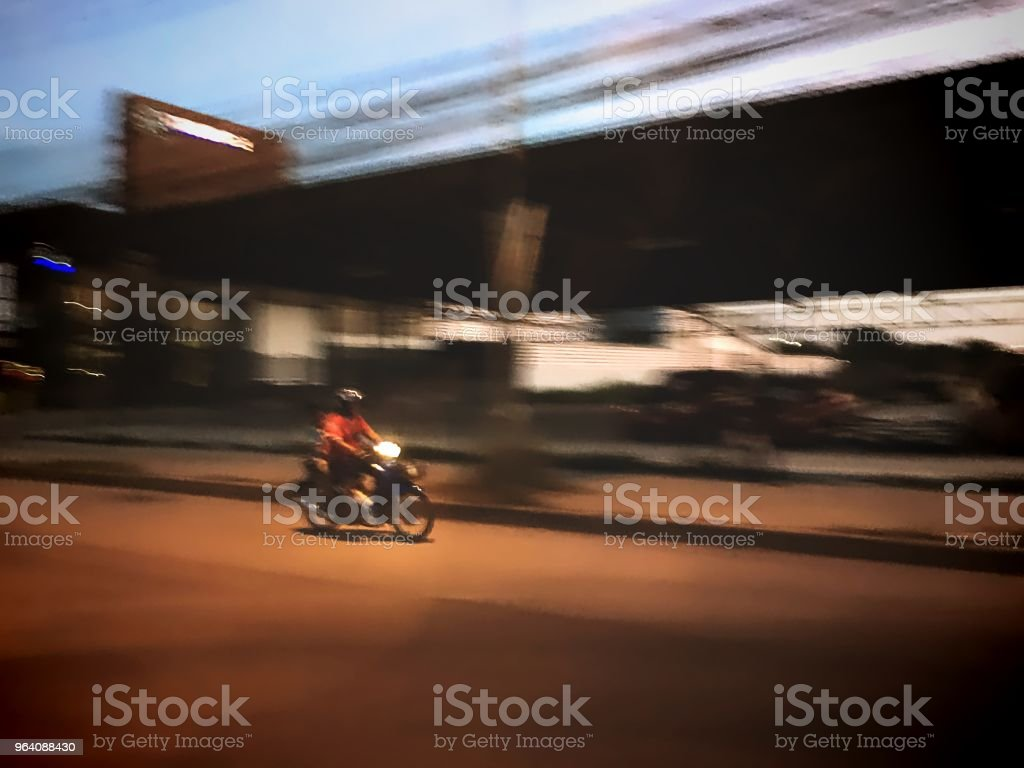 Blurred Motorcycle Riding on Street at Night - Royalty-free Adult Stock Photo