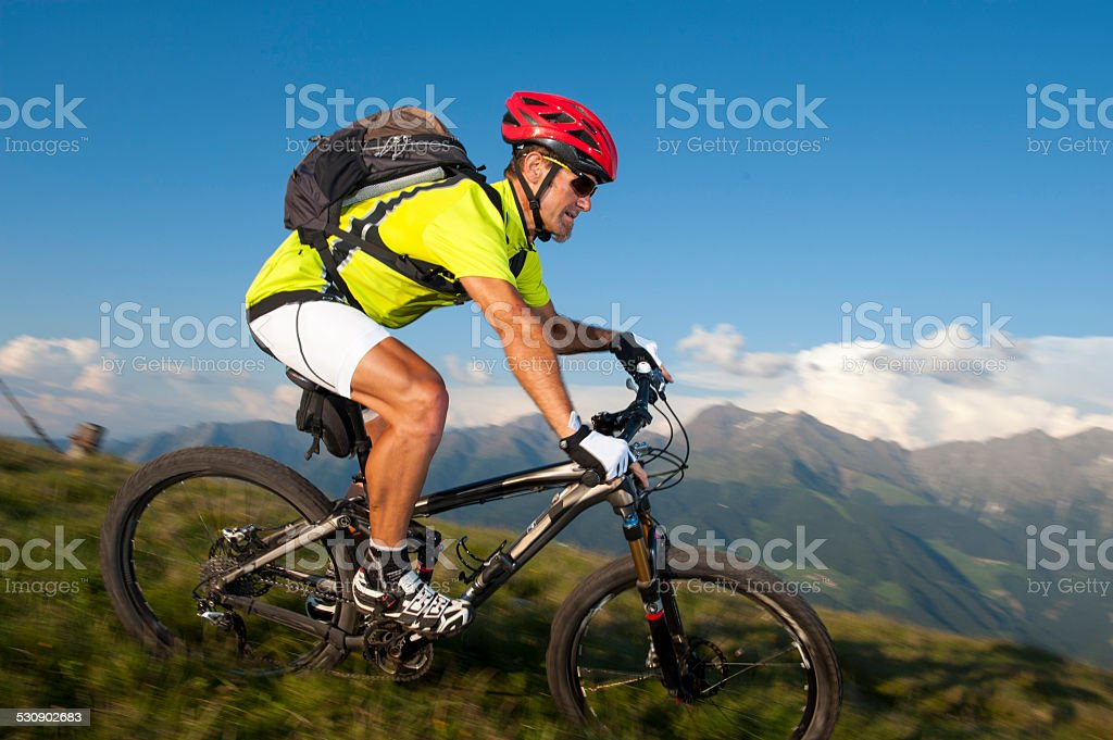 blurred mountainbike downhill stock photo