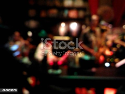 1044304084 istock photo Blurred musicians playing jazz music at the pub 598689678