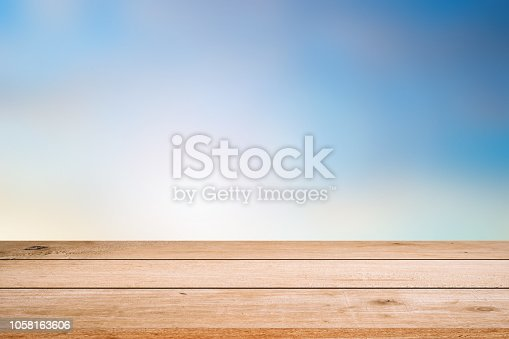 blurred natural blue sky gradient glow backdrop wall with old white wood texture panel color background texture table top.advertise,show,promote products on display