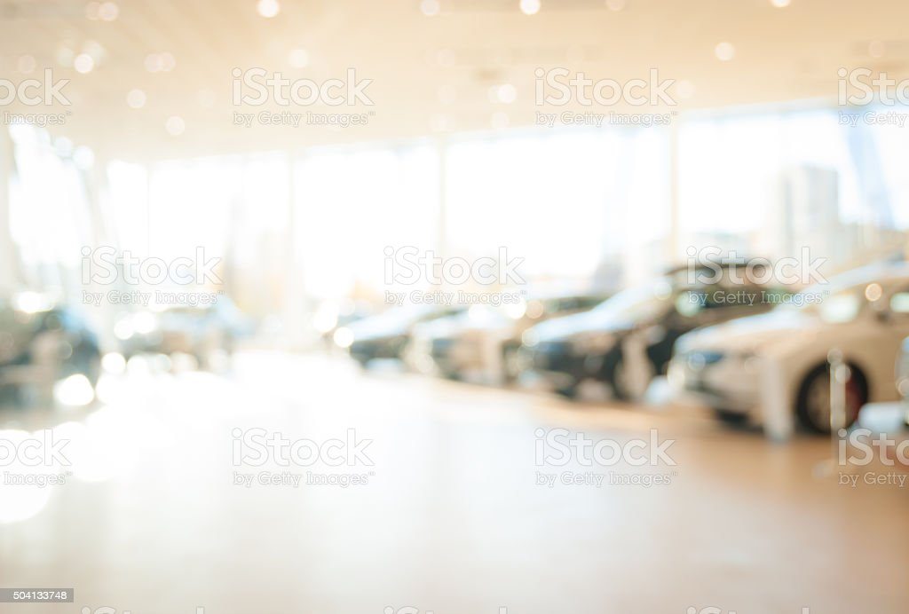 Verschwommene neuen Autos Autohaus place Lizenzfreies stock-foto