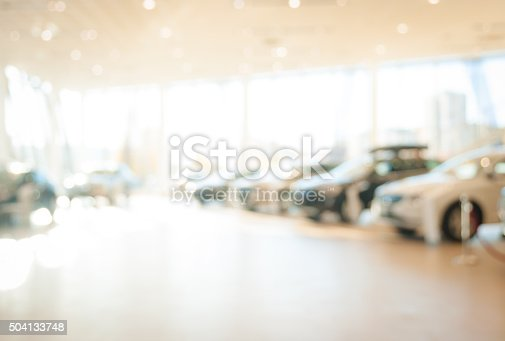 683425144 istock photo blurred  new cars dealership place 504133748