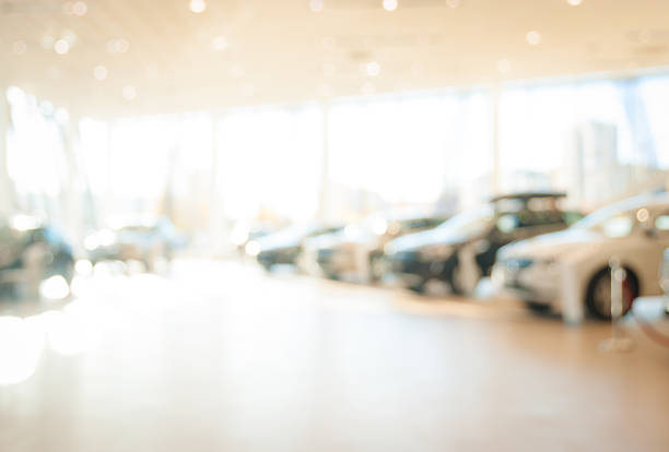 blurred  new cars dealership place - auto interieur stockfoto's en -beelden