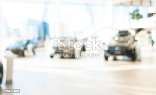 683425144 istock photo blurred  new cars dealership place 628098468