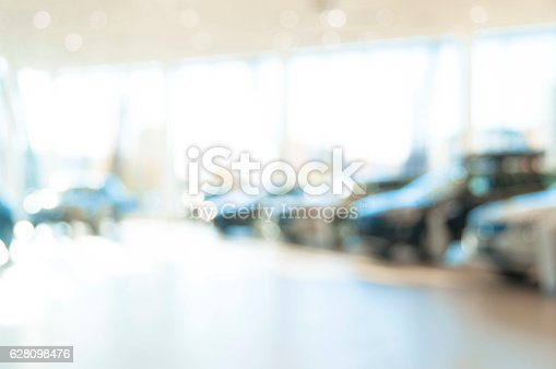 istock blurred  new cars dealership place 628098476