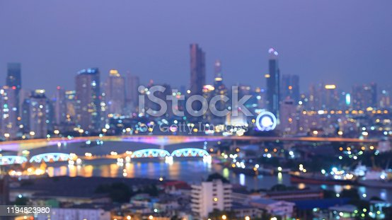 istock Blurred of bokeh city aerial view from the rooftop view point image in the night 1194823980