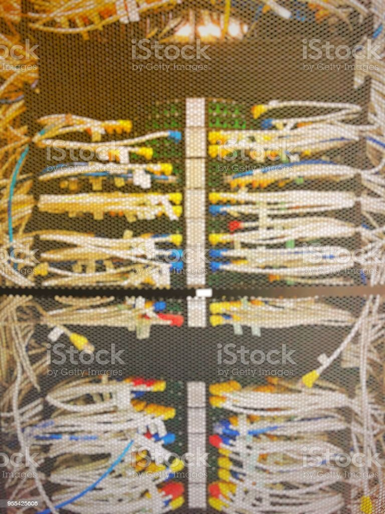 Blurred Of Complicated And Mess Lan Cable Wiring Networking In Schematic The Network Or Server Rack